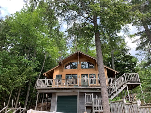 Tree House Cottage on Long Lake with boat