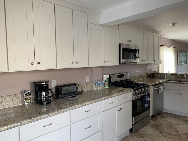 Kitchen with coffee maker and refrigerator,dishwasher and dining  wear