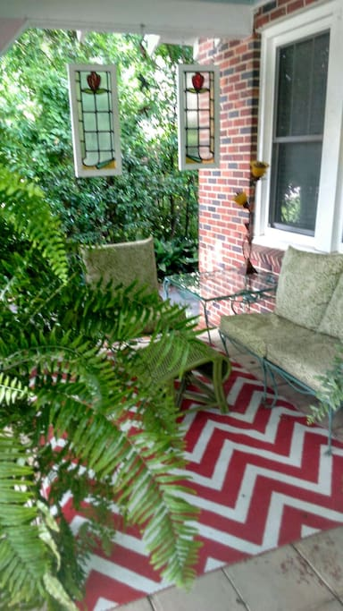 Relax on the front porch. A typical garden filled with beautiful ferns.