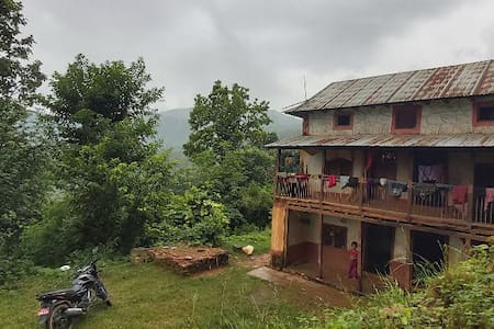 Typical Nepali living like food, house & clothes.