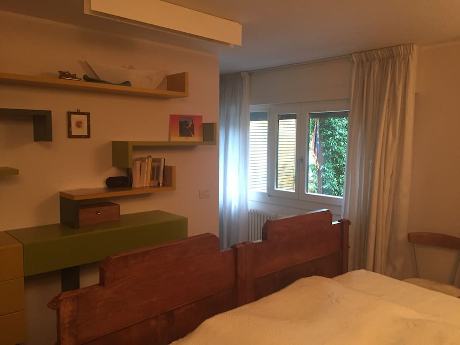 The bedroom has two large windows overlooking the front garden. Ample room for storing clothes and personal belongings