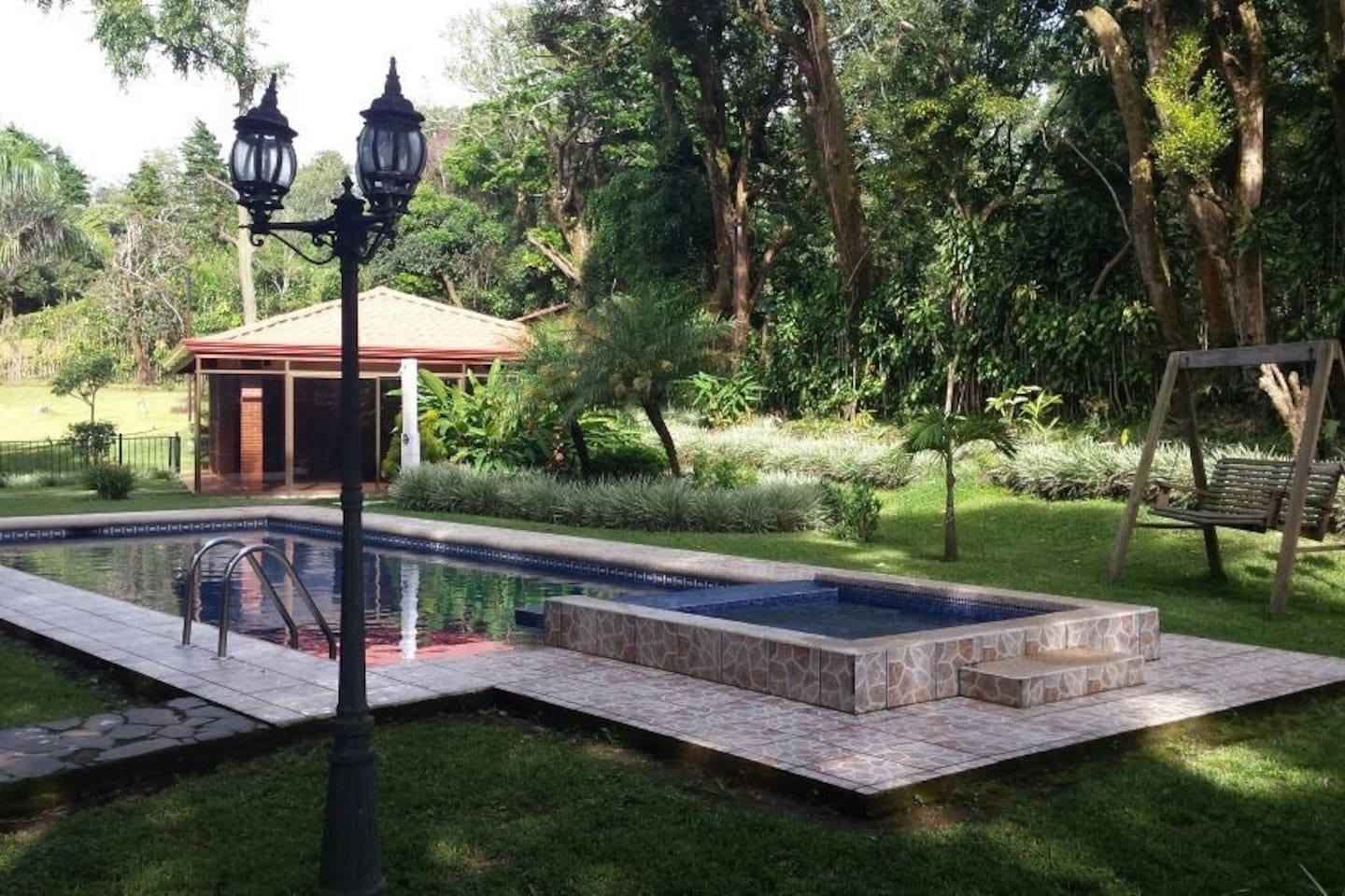 Pool on site with pool house