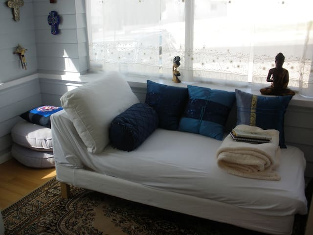 Relax in the attached meditation and reading nook.