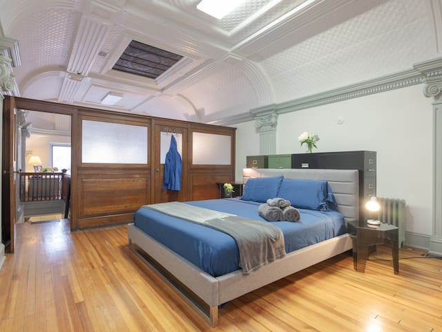 Guests rave about the comfort of the queen bed in the bedroom of this amazing loft style space.