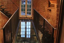 Glass and Wrought Iron Stairway, connecting house and tower.