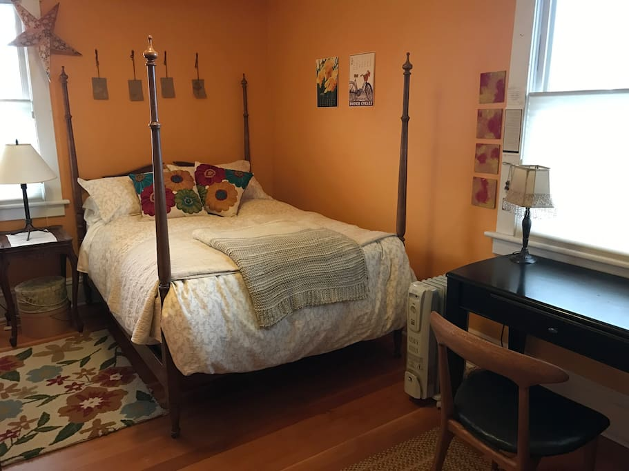 This is bedroom #1, the orange room. It has a double bed with quality mattress and linens.