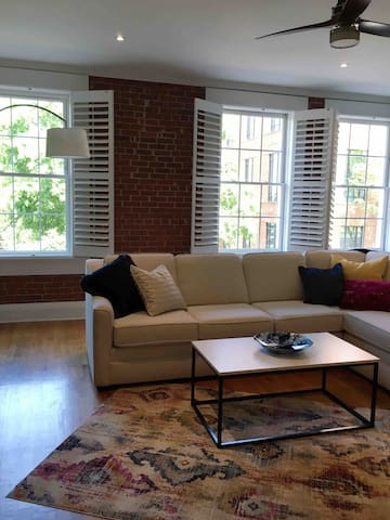 Beautiful wood plantation shutters with original exposed brick walls.