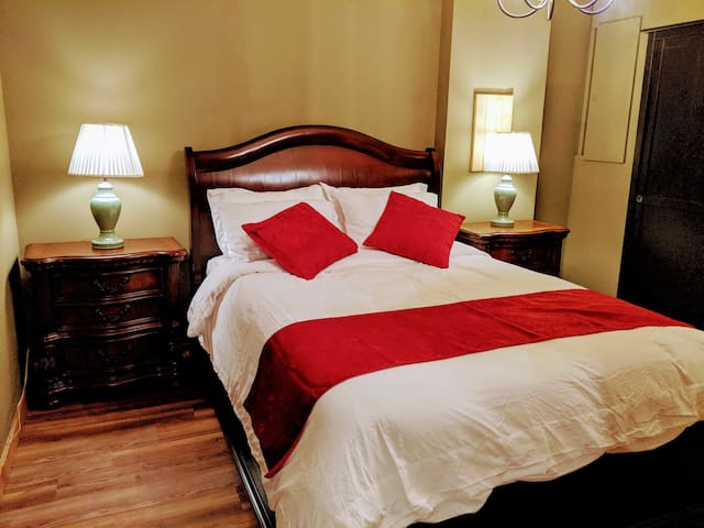 Tastefully furnished bedroom. Comfortable queen size bed.