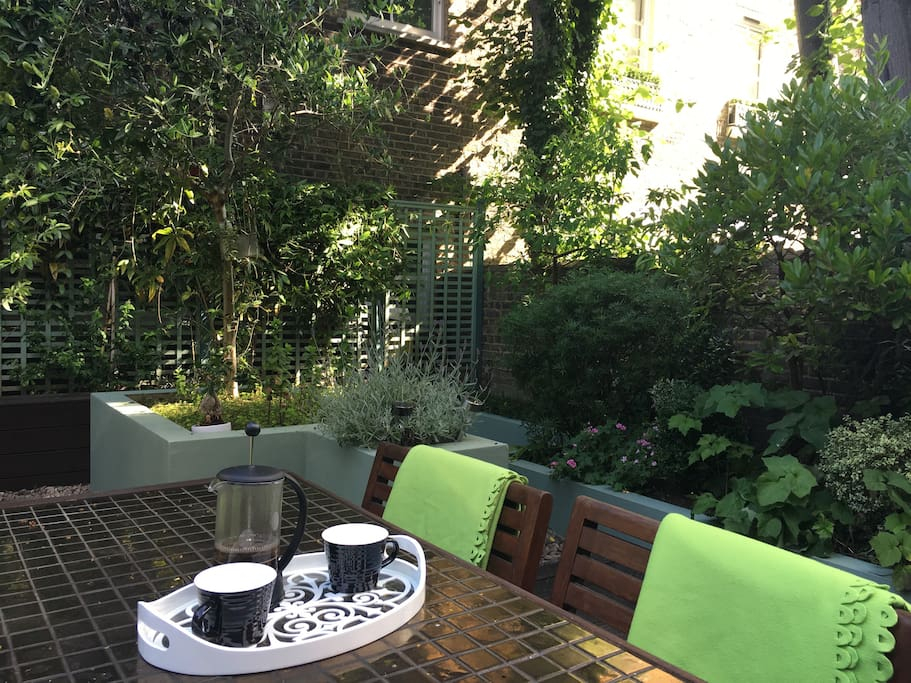 On the sunny morning enjoy cup of coffee in the garden listening to bird's singing...