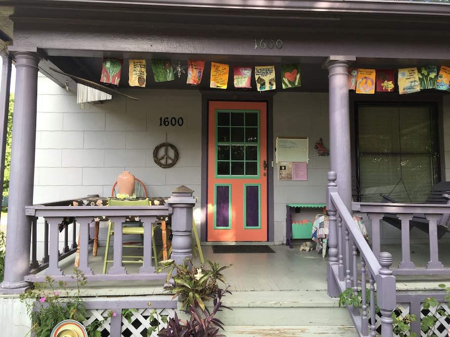 Porch welcomes you with Peace Flags Joni made.