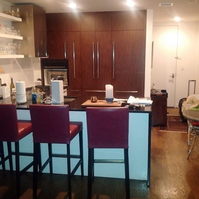 Brand new kitchen, high end appliances, bar area, table