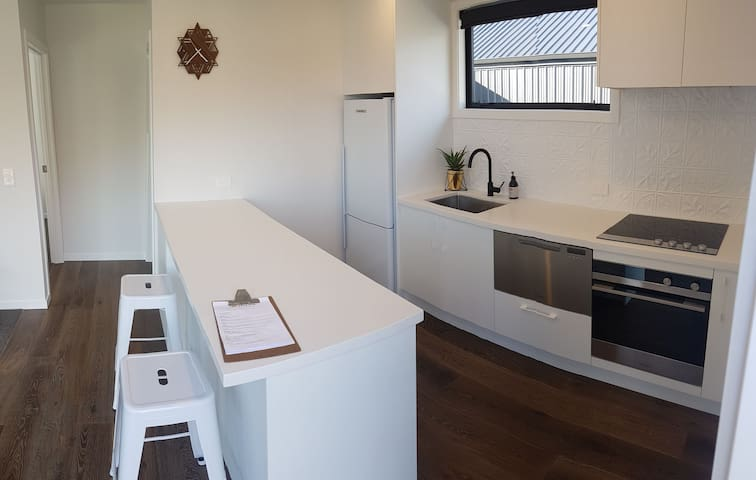 Brand new kitchen, full sized fridge/freezer, large sink, dish drawer, electric oven and cook top.