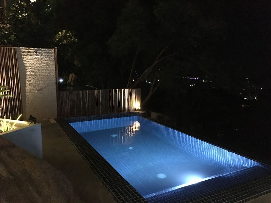The cozy pool area by night.