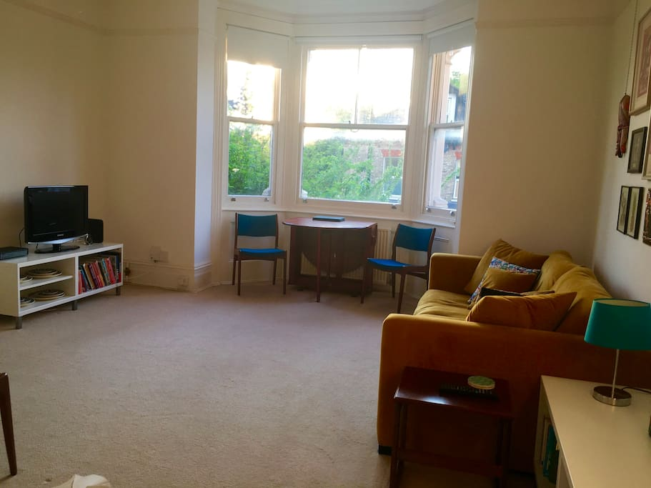LIving room including table with four chairs.