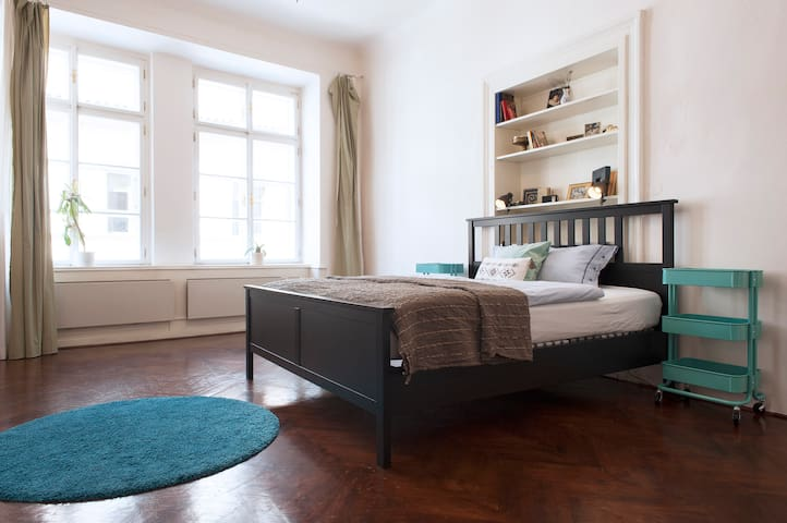 This bedroom is completely separated from the rest of the apartment and can be entered either from the living room or the hallway.