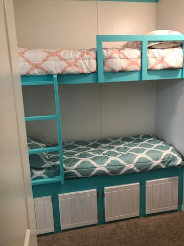 Single bunk beds for the kiddos!! Extra storage space underneath.