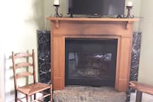Fireplace with flat screen TV in den