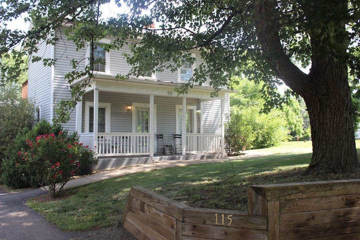 Located behind the Inn of the Shenandoah in a charmingly renovated Farmhouse sheltered by 150 year old shade trees.