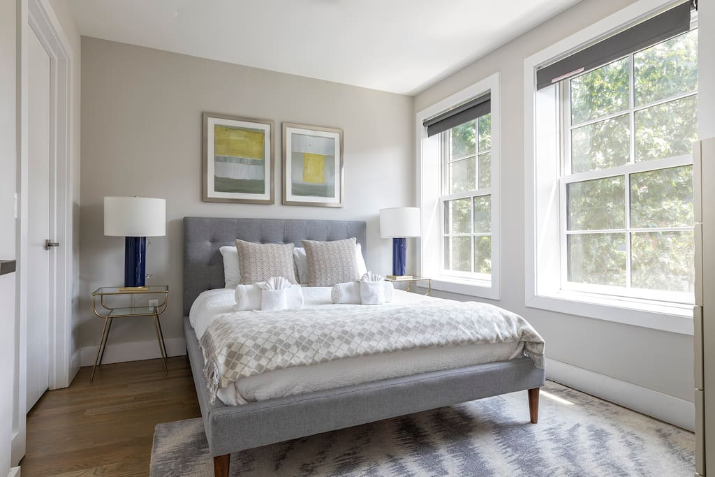 The queen-size bed in the elegant second bedroom has a super-comfortable Leesa memory foam mattress, promising a luxurious sleeping experience.