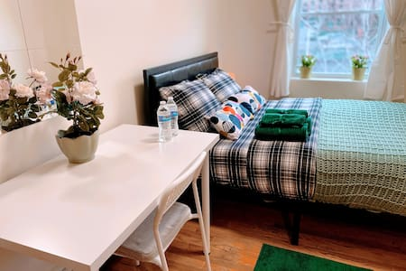 Bright and clean room in Astoria, steps from train