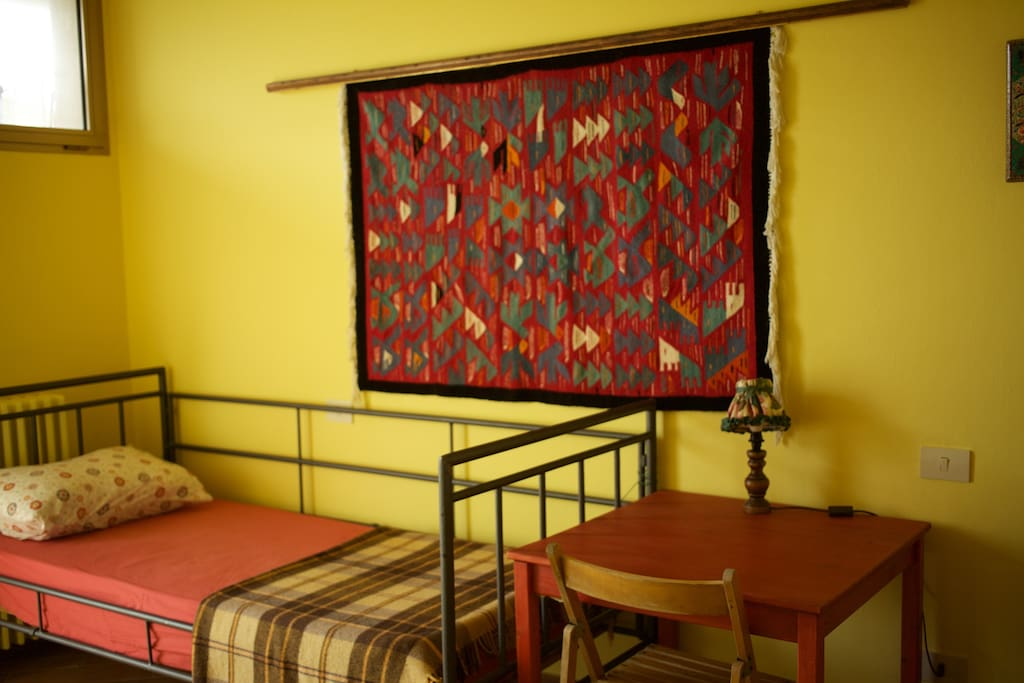 one of the single bed in guest room