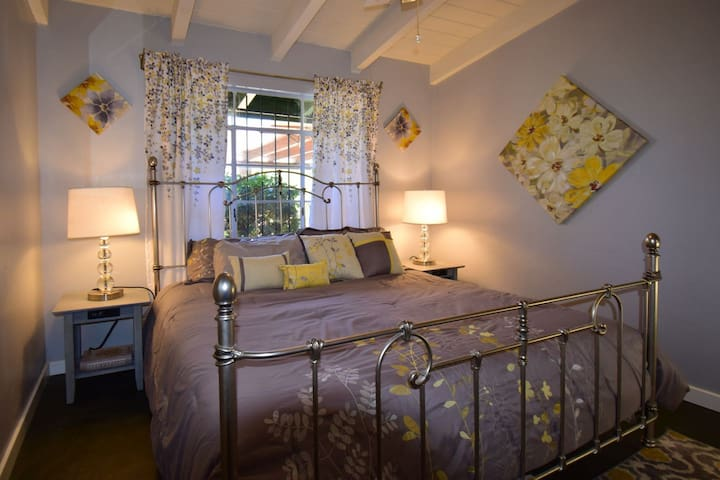 Private bedroom features king size bed with memory foam mattress topper and built-in wardrobe