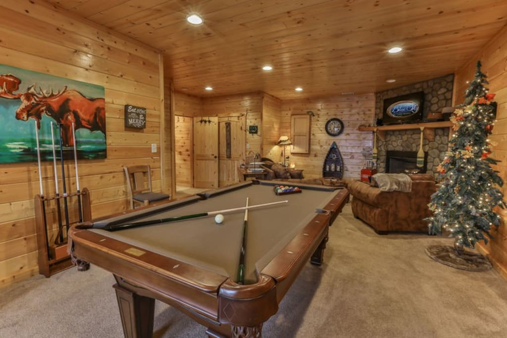 Terrace level great room with pool table and 40 inch TV above the custom stone gas fireplace