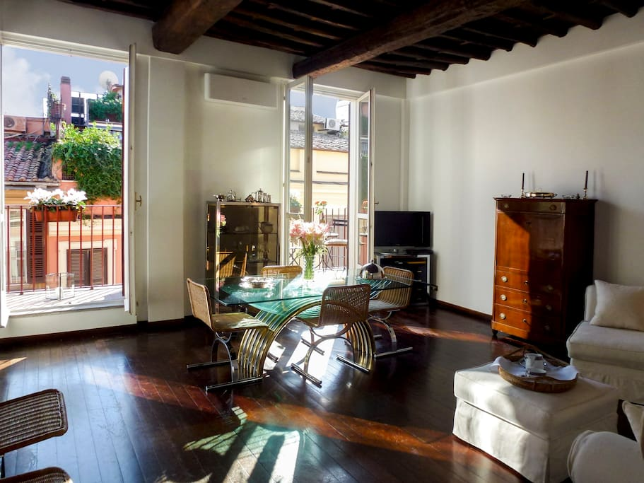 Sun filled living/dining room with two balconies overlooks Roman rooftops.