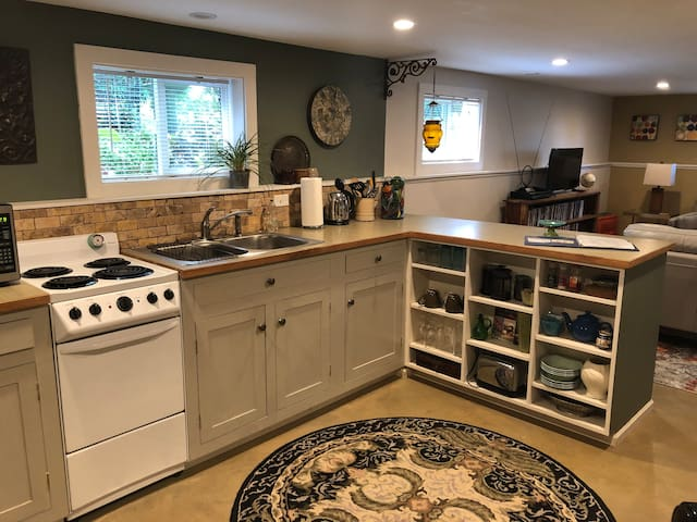 Fully equipped kitchen including fridge, oven, stove, microwave and everything you need to make a meal.