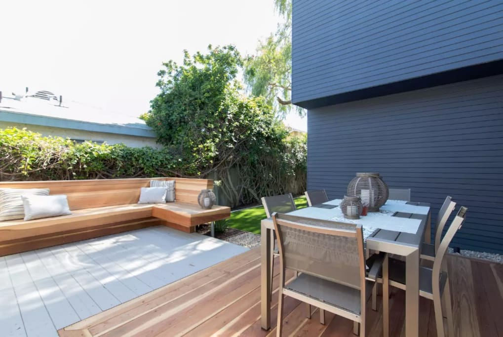 Outdoor dining space w/ lounge bench seating area.  Your in San Diego, be outside!