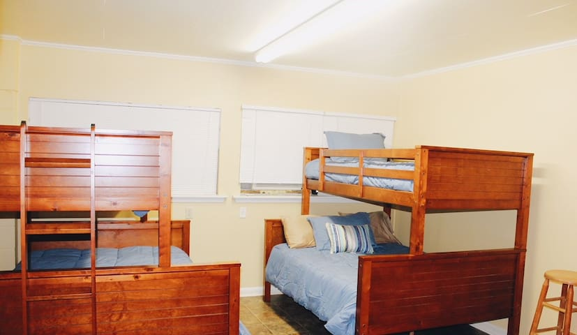 Separate Bunk Room downstairs with separate entrance, includes large sectional sofa, updated flat screen TV, full bath, small frig, washer and dryer