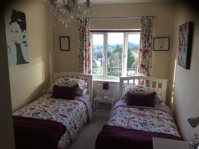 Clean light bright room close to town with views