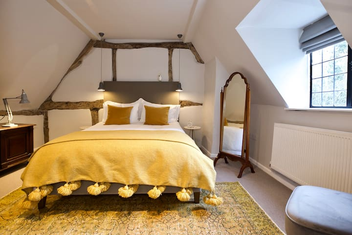 The main bedroom is spacious and very comfortable, with remote control bedside lighting