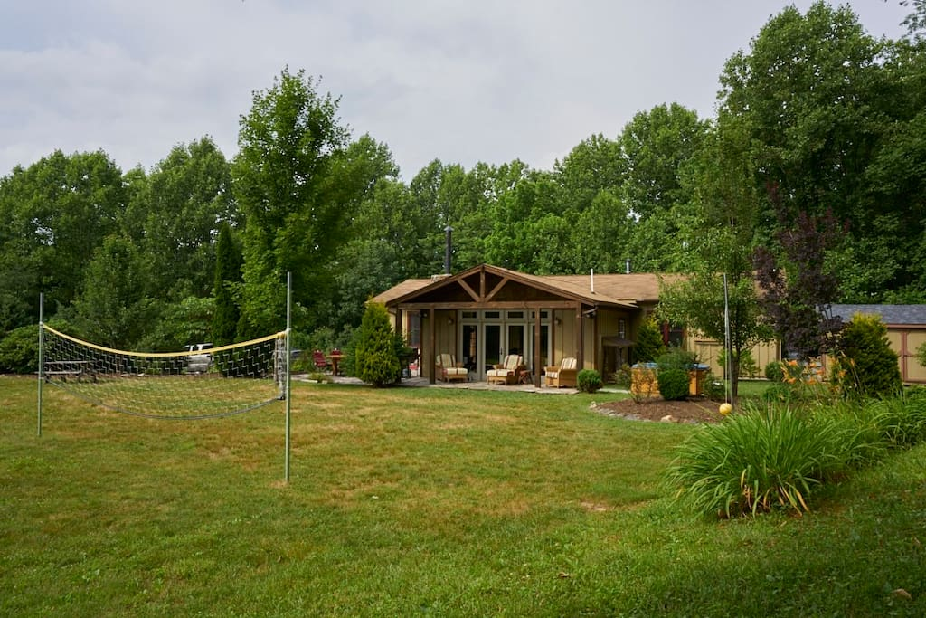 The large yard has plenty of room for a volleyball or badminton game or other yard games.