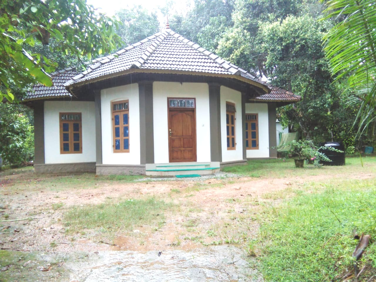 A Kerala style traditional house renovated with modern aminities located on a hill
