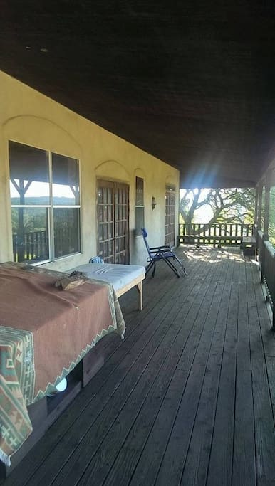 The spacious front porch with good views to the South and the East.