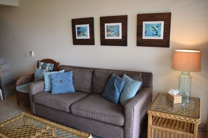 Comfortable sofa in living room with island decor