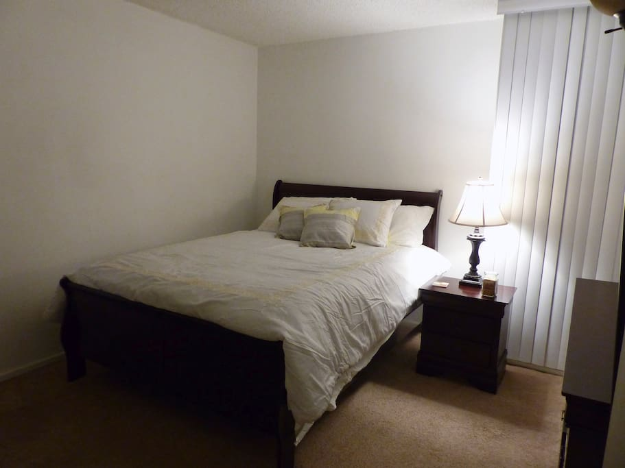 This is the room you'd be staying it. It features a queen sized bed,one window,  a dresser, and closet. It may look plain now but I change the look based on the season or holiday. But in general its a comfy, clean room. No TV yet but wifi is available.