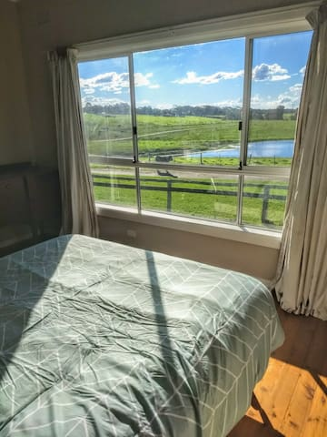 Master bedroom - magical views over the front dam - you'll never want to get out of bed!