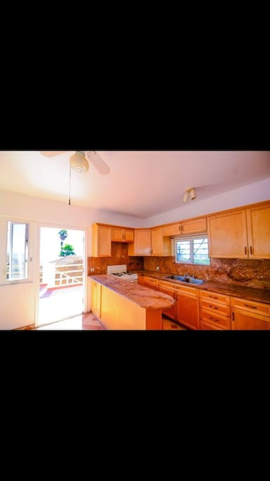 Kitchen includes full size refrigerator , stove and microwave