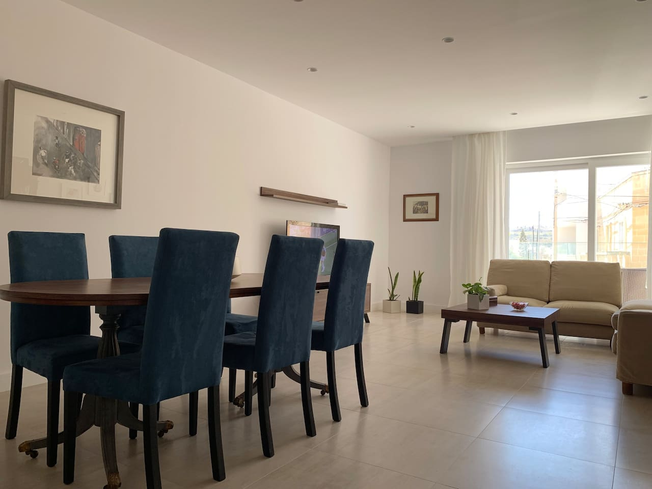 Large living / dining leading out to a lovely sunny terrace with valley views
