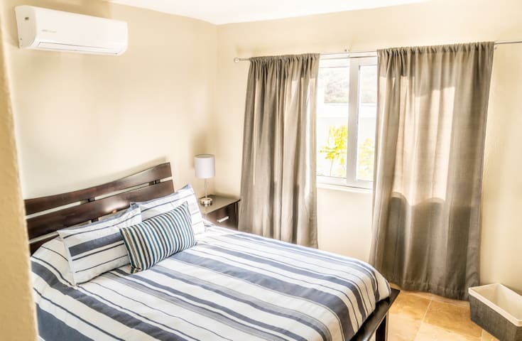 Our Guest Bedroom offers privacy and a large closet for your guests´convinience. Close the door, turn on the AC and sleep away!
