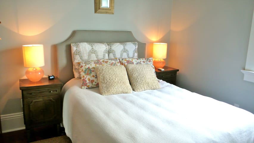 Queen size bed with plush memory foam mattress.