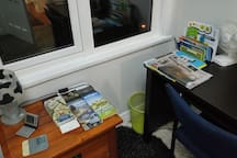 Activities, brochures, bus timetables, maps and local newspapers available in room
