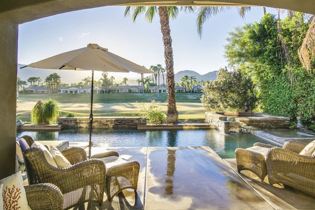 Covered Patio with dramatic western mountain views overlooking golf course.