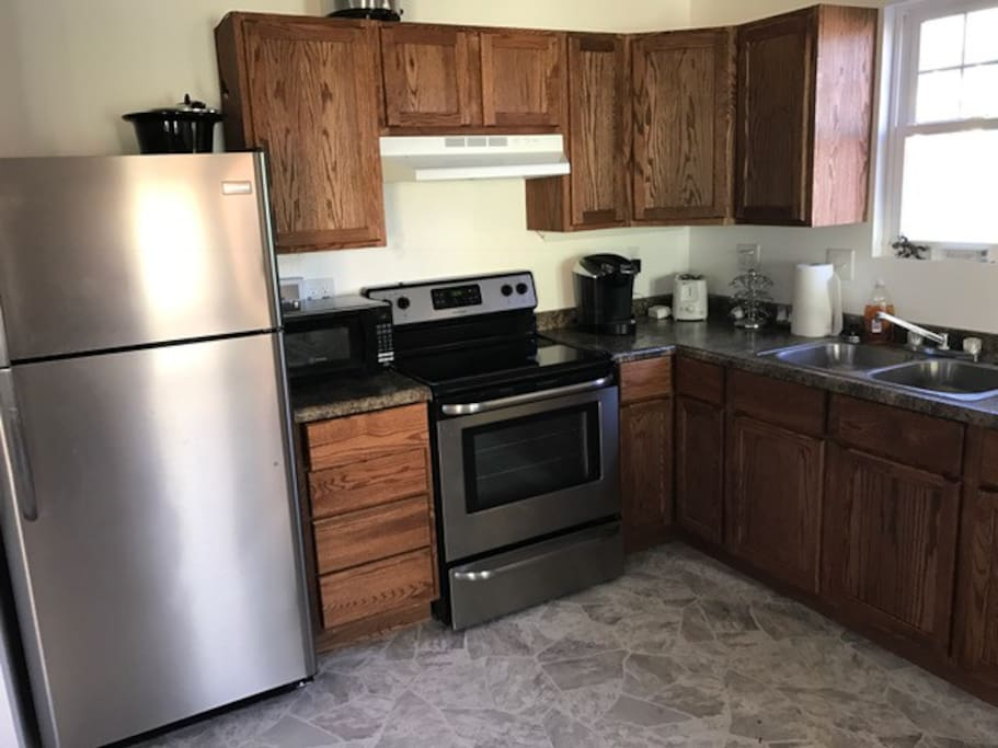 Full kitchen complete with kitchen table. Brand new appliances. Help yourself to the coffee, bottled water and snacks.