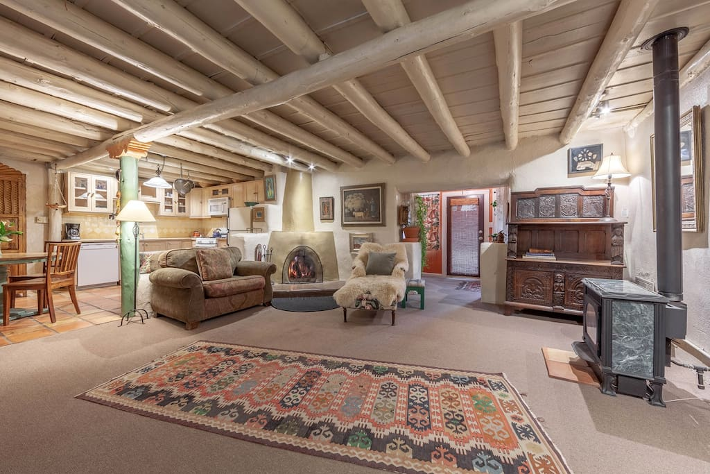 Wonderful antique furnishings and art in a very comfortable setting, complete with wood burning kiva fireplace for those romantic evenings at home.