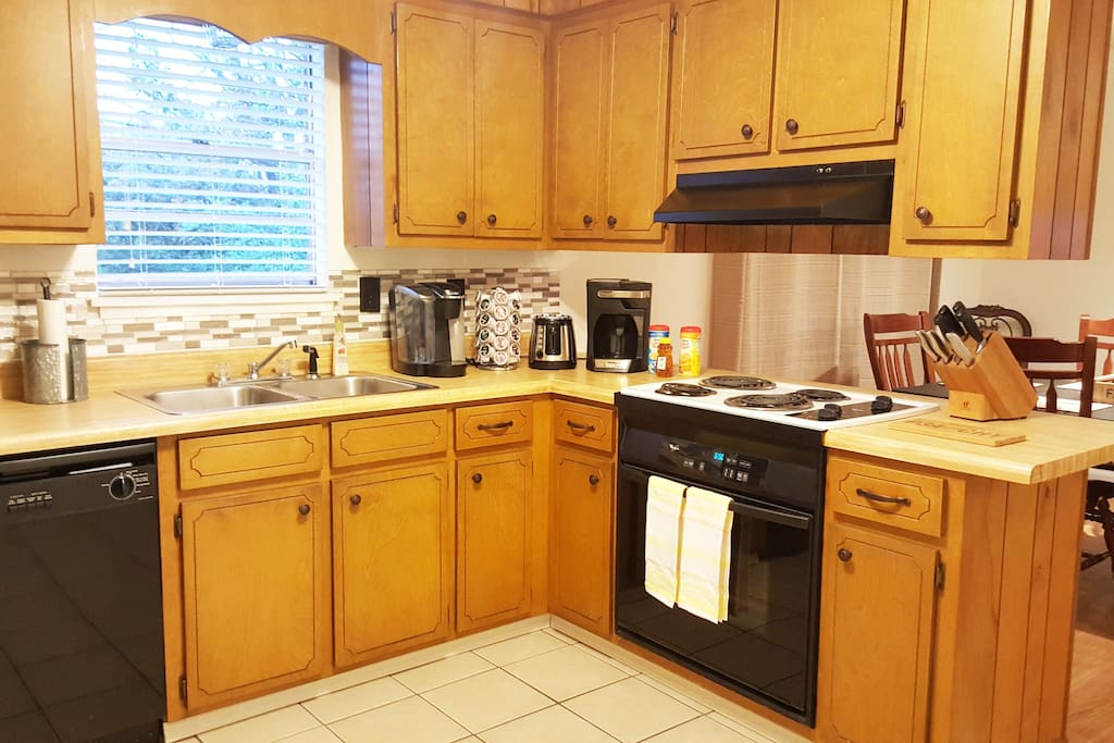 Welcoming kitchen, with cooking basics to dine-in, coffee and tea service, spices pots, pans and more.