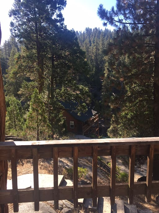 View from the deck to the gorge overlooking the South Fork of the Stanislaus River. The gentle sound of the river lulls you to a state of relaxation while lounging on the deck or on one of the boulders on the property.