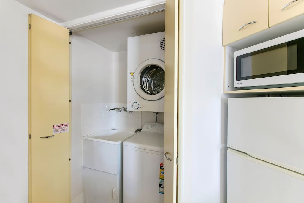 Private laundry cupboard with washing, drying and ironing facilities